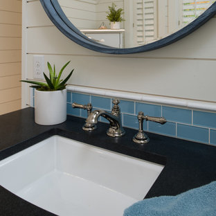 Inspiration for a large coastal 3/4 white tile and subway tile porcelain tile and multicolored floor corner shower remodel in Other with recessed-panel cabinets, white walls, an undermount sink, granite countertops, a hinged shower door and multicolored countertops