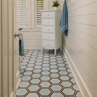 Large beach style 3/4 white tile and subway tile porcelain tile and multicolored floor corner shower photo in Other with furniture-like cabinets, white walls, granite countertops and multicolored countertops