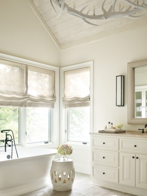 inspiration for a light wood floor bathtub remodel in atlanta with an undermount sink