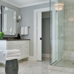 Design ideas for a medium sized beach style ensuite bathroom in Minneapolis with shaker cabinets, white cabinets, a claw-foot bath, white tiles, grey walls, white floors, a hinged door, marble tiles, marble flooring, a corner shower, a submerged sink and grey worktops.