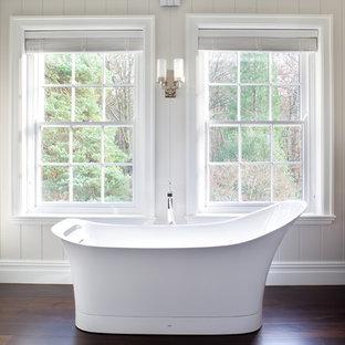 Inspiration for a transitional dark wood floor freestanding bathtub remodel in London
