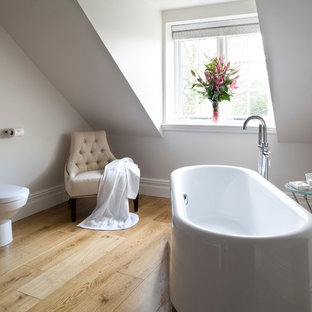 Freestanding bathtub - contemporary master freestanding bathtub idea in Other with white walls and a one-piece toilet