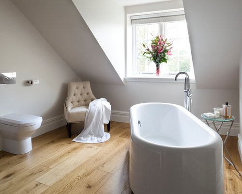master bathtub idea in other with white walls and a onepiece toilet