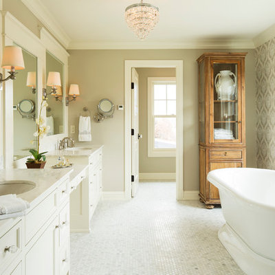 Farmhouse freestanding bathtub photo in Minneapolis with an undermount sink and marble countertops