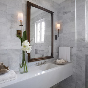 Small transitional gray tile and marble tile bathroom photo in Chicago with an integrated sink, flat-panel cabinets, white cabinets and marble countertops