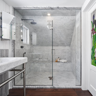 Bathroom - rustic gray tile and marble tile dark wood floor, brown floor and shiplap wall bathroom idea in Ottawa with white walls, a console sink and a hinged shower door