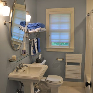Inspiration for a small timeless 3/4 white tile and ceramic tile linoleum floor bathroom remodel in New York with a pedestal sink, a two-piece toilet and blue walls