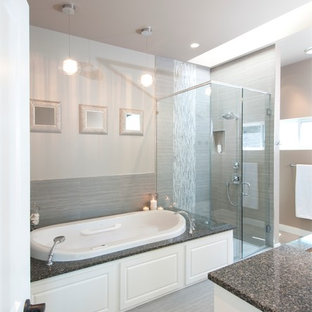 Inspiration for a large contemporary master gray tile and porcelain tile porcelain floor bathroom remodel in Vancouver with an undermount sink, raised-panel cabinets, white cabinets, engineered quartz countertops, a two-piece toilet and gray walls