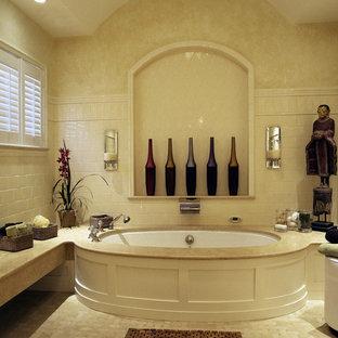 Bathroom - traditional beige tile bathroom idea in Boston with an undermount tub