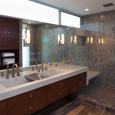 Alcove shower - large contemporary master mosaic tile, black tile, brown tile and gray tile porcelain tile alcove shower idea in Austin with flat-panel cabinets, medium tone wood cabinets, multicolored walls, a trough sink and quartz countertops