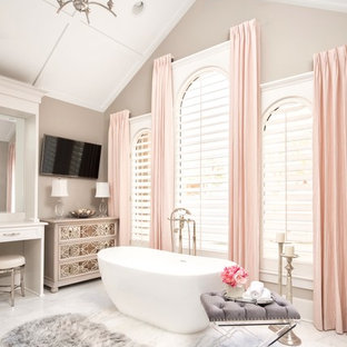 Transitional master marble floor and white floor freestanding bathtub photo in Charlotte with gray walls