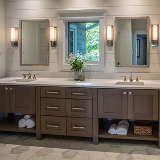 Large transitional master white tile and ceramic tile ceramic floor and gray floor double shower photo in Other with furniture-like cabinets, medium tone wood cabinets, a two-piece toilet, white walls, an undermount sink, engineered quartz countertops and a hinged shower door