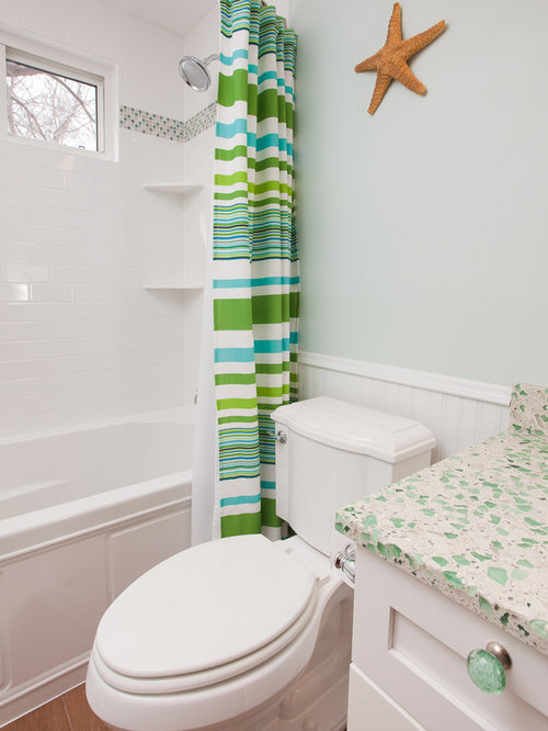 coastal bathroom photo in minneapolis with recycled glass countertops and mosaic tile