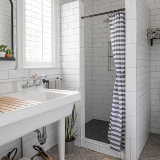 Design ideas for a large beach style ensuite bathroom in Minneapolis with an alcove shower, white tiles, metro tiles, a console sink, grey floors, a shower curtain, open cabinets, white walls, porcelain flooring and solid surface worktops.