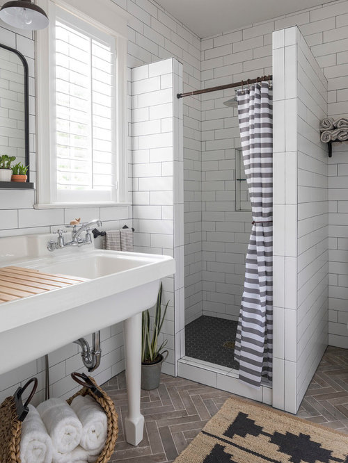 coastal white tile and subway tile gray floor bathroom photo in minneapolis with a console sink