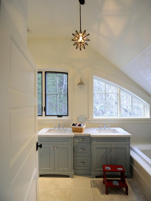 Beach Style Bathroom Idea In Toronto With Blue Cabinets