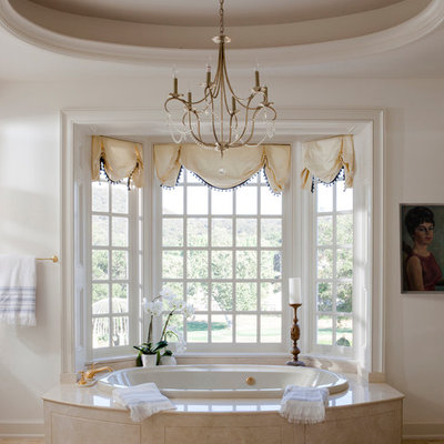 Inspiration for a large timeless master beige tile and stone tile drop-in bathtub remodel in Los Angeles with white walls