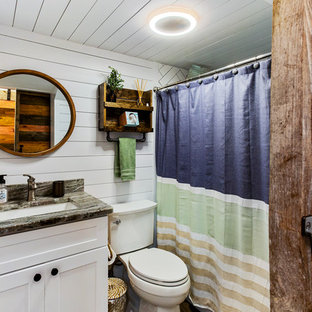 Coastal white tile shower curtain photo in Boston with shaker cabinets, turquoise cabinets, white walls, an undermount sink and gray countertops