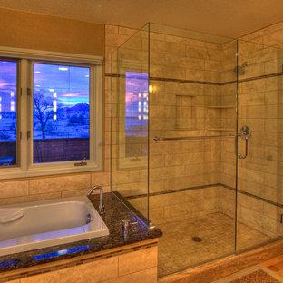 デンバーの大きいトランジショナルスタイルのおしゃれなマスターバスルーム (シェーカースタイル扉のキャビネット、中間色木目調キャビネット、ドロップイン型浴槽、アルコーブ型シャワー、ベージュのタイル、セラミックタイル、ベージュの壁、淡色無垢フローリング、アンダーカウンター洗面器、御影石の洗面台、分離型トイレ、茶色い床、開き戸のシャワー) の写真