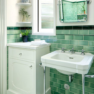 Example of a mid-sized tuscan master green tile and ceramic tile ceramic floor tub/shower combo design in Los Angeles with beaded inset cabinets, white cabinets, an undermount tub, beige walls, a pedestal sink and marble countertops