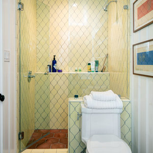 Inspiration for a small mediterranean shower room in Los Angeles with an alcove shower, a two-piece toilet, yellow tiles, ceramic tiles, white walls, ceramic flooring and a wall-mounted sink.