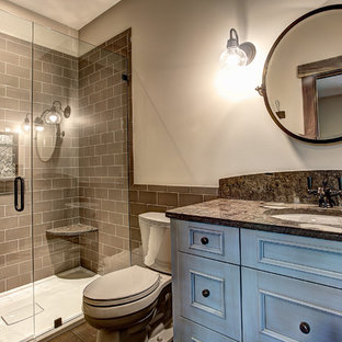 Doorless shower - mid-sized craftsman master gray tile and subway tile ceramic tile doorless shower idea in Grand Rapids with an undermount sink, shaker cabinets, blue cabinets, granite countertops, a two-piece toilet and beige walls