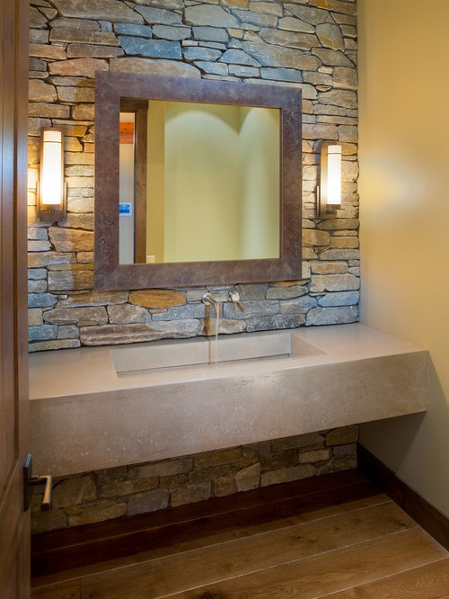 inspiration for a rustic bathroom remodel in vancouver with a trough sink and concrete countertops