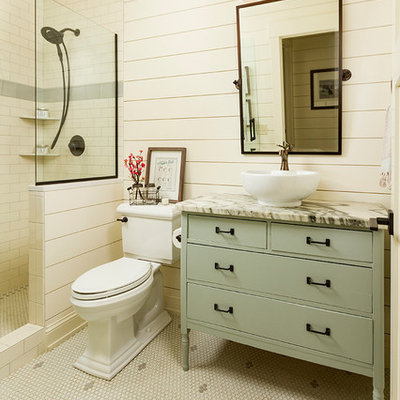 Mid-sized farmhouse 3/4 white tile and subway tile mosaic tile floor bathroom photo in Minneapolis with a two-piece toilet, a vessel sink, marble countertops, flat-panel cabinets, green cabinets and beige walls