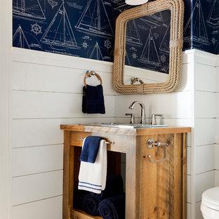 Immagine di una stanza da bagno stile marino con nessun'anta, ante in legno scuro, pareti multicolore, lavabo da incasso, top in legno e pavimento multicolore