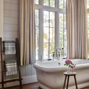 Inspiration For A Rustic Dark Wood Floor And Brown Floor Freestanding  Bathtub Remodel With Gray Walls