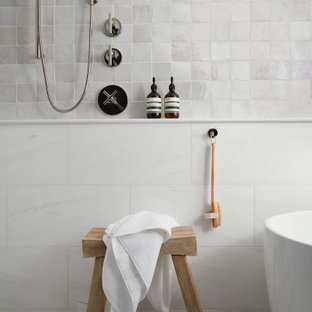 Example of a mid-sized eclectic master white tile and terra-cotta tile marble floor and white floor bathroom design in Chicago with furniture-like cabinets, distressed cabinets, a one-piece toilet, white walls, a vessel sink, quartz countertops and white countertops