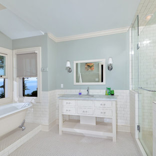 Example of a classic subway tile freestanding bathtub design in Cleveland
