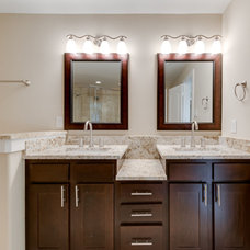 Traditional Bathroom by JNT Developers