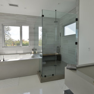 Inspiration for a large modern master bathroom in Los Angeles with open cabinets, black cabinets, a hot tub, an alcove shower, grey walls, a trough sink and solid surface benchtops.