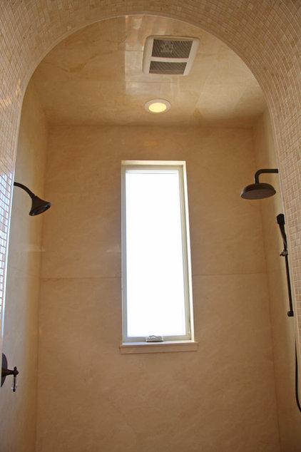 Mediterranean Bathroom by Landmark Builders