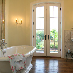 Inspiration for a timeless freestanding bathtub remodel in Sacramento with a pedestal sink