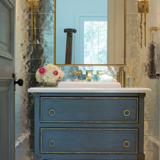 Photo of a mid-sized shabby-chic style 3/4 bathroom in Houston with furniture-like cabinets, blue cabinets, a drop-in sink, mirror tile, ceramic floors, engineered quartz benchtops and grey floor.