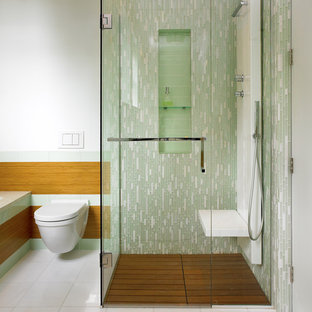 Walk-in shower - contemporary green tile and glass tile walk-in shower idea in Vancouver with a wall-mount toilet