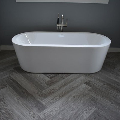 Mid-sized transitional master gray tile, white tile and porcelain tile porcelain tile and gray floor bathroom photo in Minneapolis with raised-panel cabinets, gray cabinets, a two-piece toilet, gray walls, a vessel sink and quartz countertops