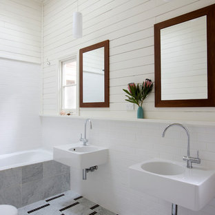 This is an example of a large country master bathroom in Sydney with an alcove tub