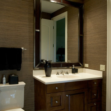 Large wood mirror trimmed in metal and grass cloth walls