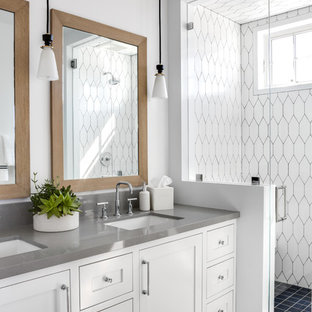 Inspiration for a beach style 3/4 white tile blue floor alcove shower remodel in Orange County with shaker cabinets, white cabinets, white walls, an undermount sink, a hinged shower door and gray countertops