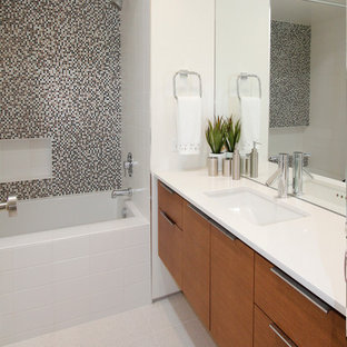 Inspiration for a mid-sized 1960s 3/4 multicolored tile and mosaic tile bathroom remodel in Los Angeles with flat-panel cabinets, medium tone wood cabinets, white walls, an undermount sink and engineered quartz countertops
