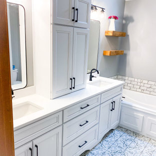 This is an example of a small shabby-chic style master bathroom in Kansas City with recessed-panel cabinets, white cabinets, a drop-in tub, an open shower, a two-piece toilet, gray tile, marble, grey walls, porcelain floors, an undermount sink, engineered quartz benchtops, multi-coloured floor, a hinged shower door, white benchtops, a double vanity and a built-in vanity.