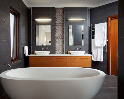 Example of a mid sized trendy gray tile freestanding bathtub design in  Perth with a. Flower Tiles   Houzz