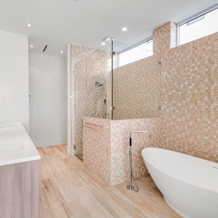 Inspiration for a contemporary master beige tile beige floor bathroom remodel in Miami with light wood cabinets, white walls, an undermount sink, a hinged shower door and white countertops