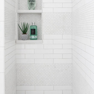 Inspiration for a kids' white tile and porcelain tile marble floor alcove shower remodel in New York with a hinged shower door