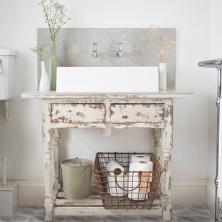 Photo of a shabby-chic style bathroom in London.