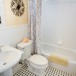 Small transitional 3/4 white tile and subway tile mosaic tile floor and white floor bathroom photo in Cincinnati with a one-piece toilet, yellow walls and a pedestal sink