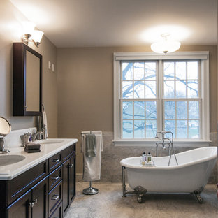 Bathroom - large traditional master gray tile and porcelain tile porcelain tile bathroom idea in DC Metro with recessed-panel cabinets, dark wood cabinets, a two-piece toilet, gray walls, an undermount sink and solid surface countertops